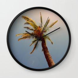 Palm tree under the sun Wall Clock
