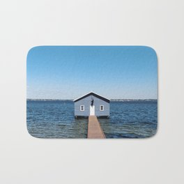 A Blue Boat House, Sky and Harbour in Perth, Western Australia Bath Mat