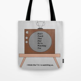 The T.V. is watching us Tote Bag