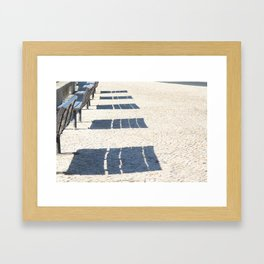 Shadows of empty benches Framed Art Print