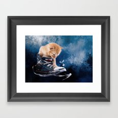 Cute kitten plays in sneakers Framed Art Print