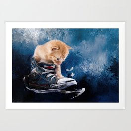 Cute kitten plays in sneakers Art Print
