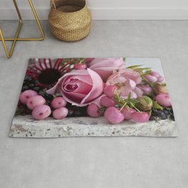 soft pink rose and berry still life Rug