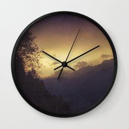 Chasing the night away Wall Clock