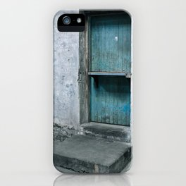 What's behind the old blue door? iPhone Case