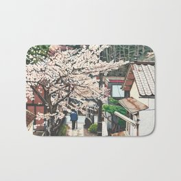 Passing by Cherry Blossoms Bath Mat