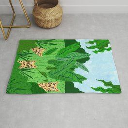 Leopards in the jungle Rug