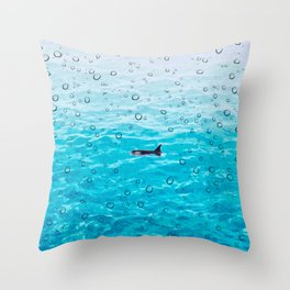 Orca Whale gliding through the water on a rainy day Throw Pillow