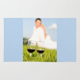 Two wineglasses with red wine in grass Rug