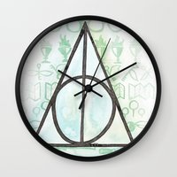 deathly hallows Wall Clocks featuring Deathly Hallows by Carmen McCormick