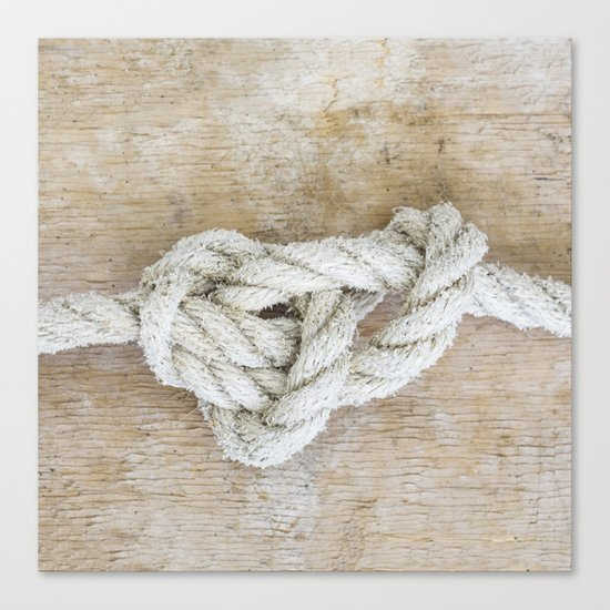 Knot on driftwood Canvas Print