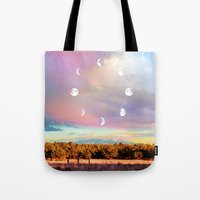 moon phases Tote Bags featuring Moon Phases by LoveFreeMovement