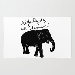 Ride bicycles not elephants. Black text Rug