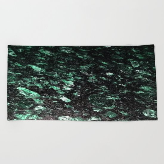 The Jade Sleeping Beneath the Black Granite Beach Towel