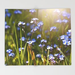 Forget me not flowers in sunlight Throw Blanket