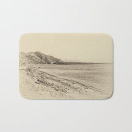 Tranquil bay view in sepia Bath Mat