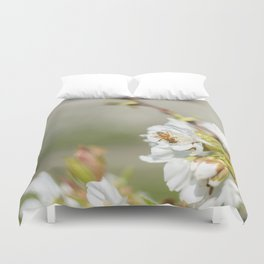 Bee laid on white flowers of a cherry tree Duvet Cover