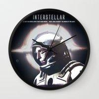 interstellar Wall Clocks featuring interstellar by Saalk