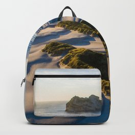 wharariki beach sunset sand dunes natural reserve Backpack