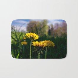 Concept flora : Dandelions in a field Bath Mat