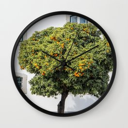 Orange tree in the old city center of Faro, Portugal Wall Clock