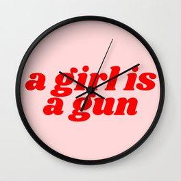a girl is a gun Wall Clock