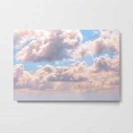 Illuminated fluffy clouds in a blue sky Metal Print