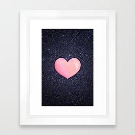 Pink heart on shiny black Framed Art Print
