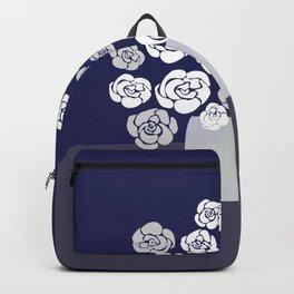 White Roses in Vase on Blue Backpack