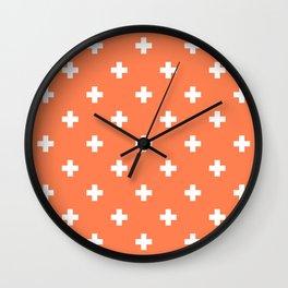Swiss cross pattern on coral Wall Clock