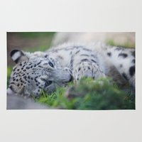 snow leopard Area & Throw Rugs featuring Snow Leopard  by Dimind