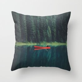 man canoeing on a forest lake Throw Pillow