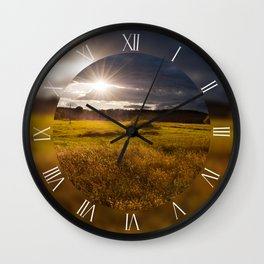 Awesome sunset above meadow Wall Clock