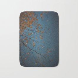 Burnt Orange Leaves on Midnight Blue Sky Bath Mat