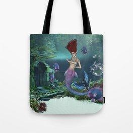 Wonderful mermaid in the deep ocean Tote Bag