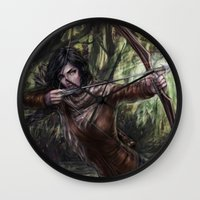 katniss Wall Clocks featuring Katniss by jasric