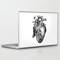 anatomical heart Laptop & iPad Skins featuring heart by Isa Ribeiro