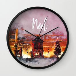 A tiny Christmas village on my mantle says Noel Wall Clock