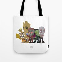 starlord Tote Bags featuring Guarding the Galaxy by Nate Kelly