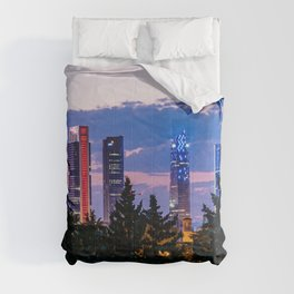 Cityscape of financial district of Madrid at sunset Comforters