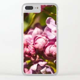 Branch of fresh purple lilac flowers in a city public park close-up Clear iPhone Case