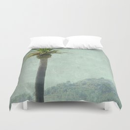 A palm tree on the mountain Duvet Cover