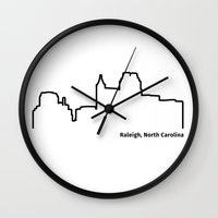 north carolina Wall Clocks featuring Raleigh, North Carolina by Fabian Bross