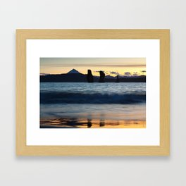 Three rocky islands in Pacific Ocean at beautiful sunset Framed Art Print