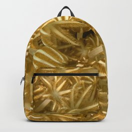 Grasping (in gold) Backpack