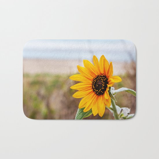 Sunflower near ocean Bath Mat