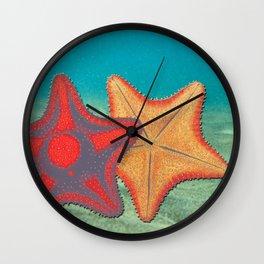 Vintage sketch of sea stars on blue Wall Clock