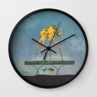 yetiland Wall Clocks featuring Dalimt Prehistoric Fantasy by Paula Belle Flores