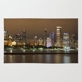 Beautiful river side city view in the night with colorful lights and tall buildings Rug
