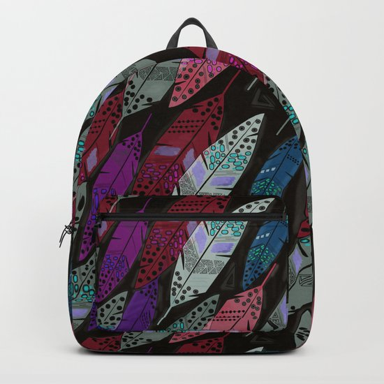 Multi colored feathers on black background . Backpack
